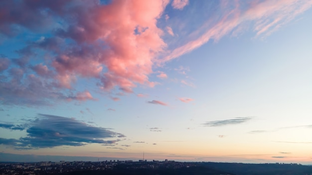 Sky covered with rose colored clouds at sunset in chisinau, moldova