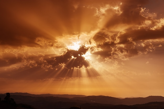 Sky with clouds and sun rays. sunset over mountains. summer evening. dramatic sky. beautiful conceptual meditation.
