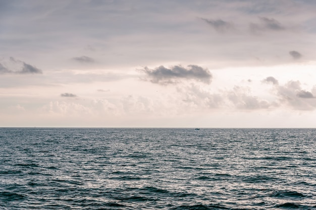 The sky with clouds, waves on sea surface