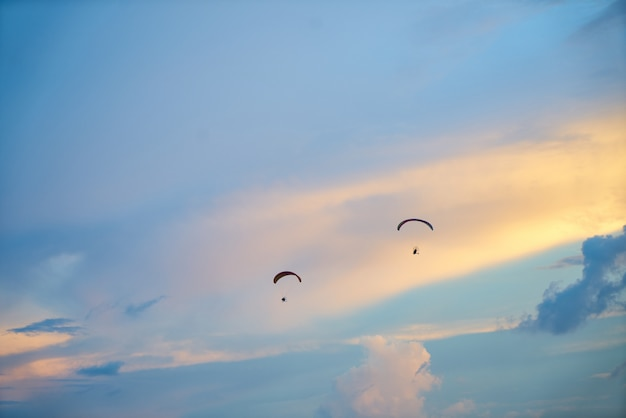 Sky with two people in parachute