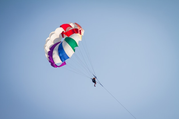 Skydiver on colorful parachute