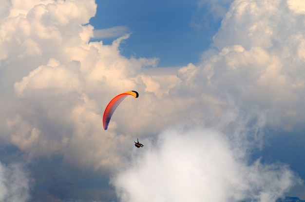 Skydiver flies over the mountains