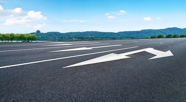 Skyline of asphalt pavement and blue sky and white cloud