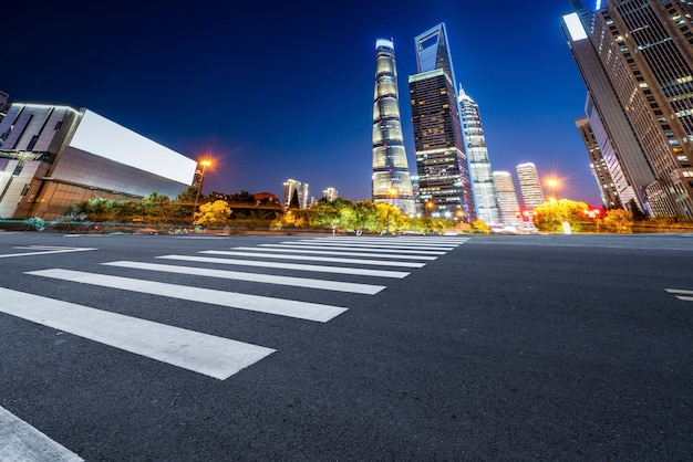 Skyline of asphalt pavement and night scenery of shanghai architectural landscape