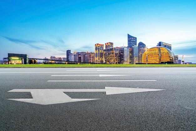 Skyline of asphalt pavement and nightscape of modern architectural landscape