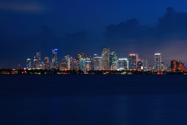 Skyline city miami lighting lights sea ocean sunset night cityscape buildings downtown architecture ...