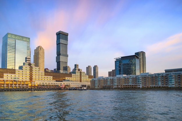 Skyline of jersey city, new jersey from new york harbor in usa