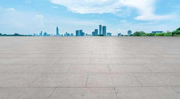 Skyline of plaza brick pavement and nanjing architecture