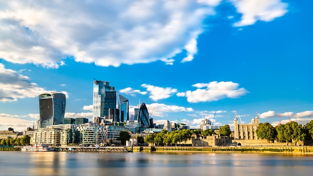 Skyscrapers of the city of london and the tower of london at the thames river, england