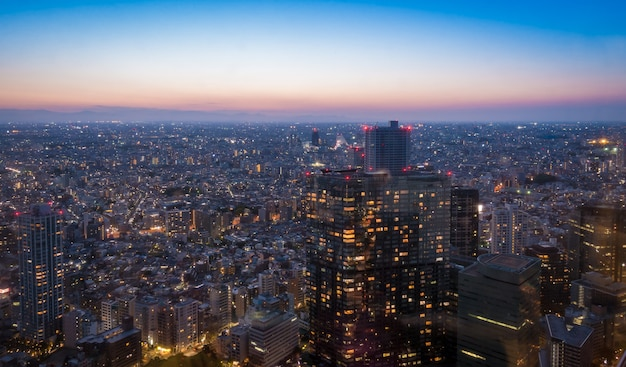 Skyscrapers in shibuya lighten up at sun set.