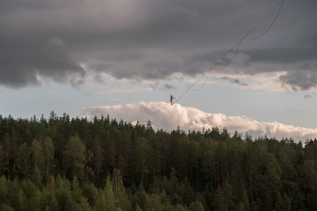 Slackline at high altitude. a man walking on a tight rope