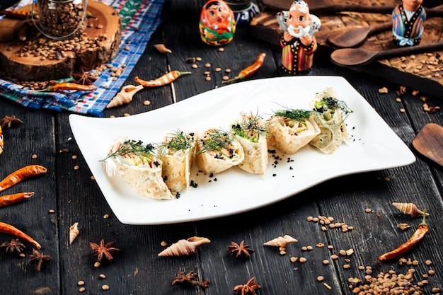 Slapjack rolls with salmon filling black caviar