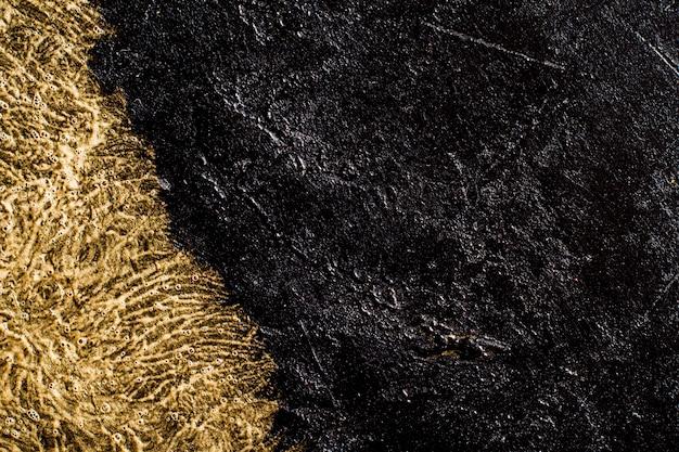 黄金の詳細とスレートの背景