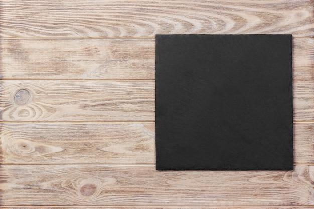 Slate blackboard on wooden table