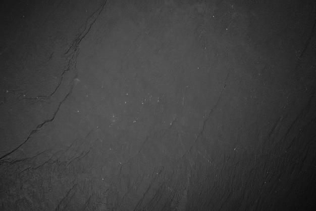 Slate board on black wood Premium Photo