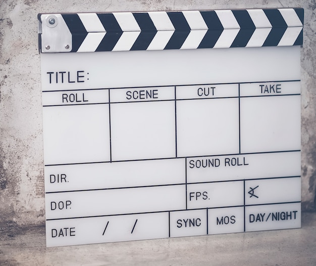 The slate film is used to film the movie on the cement floor.