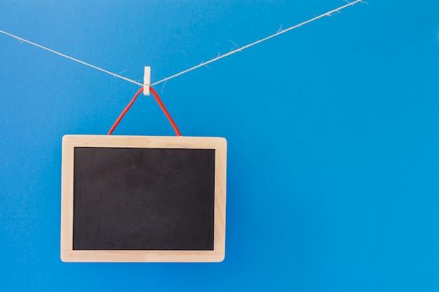 Slate hanging on clothesline