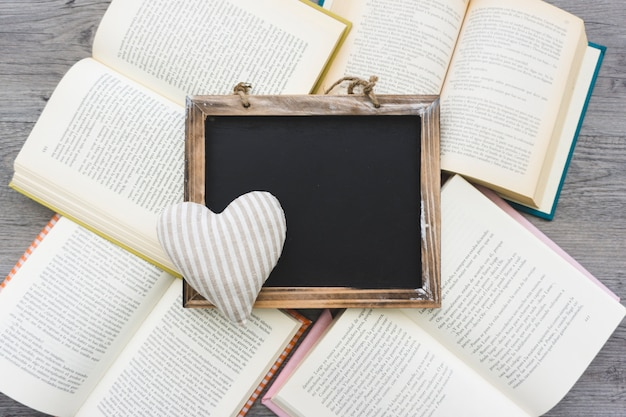 Slate and heart on open books