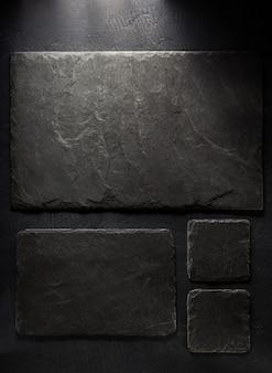 Шиферная вывеска на черном фоне текстуры