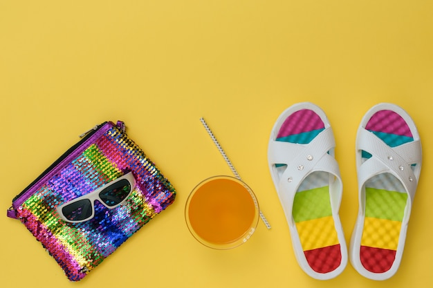 Slates, colorful bag and glasses on yellow background