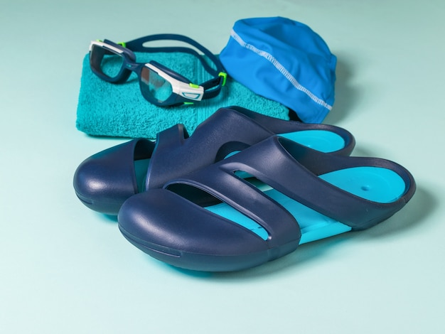 Slates for the pool, glasses, hat and towel. accessories for swimming in the pool.