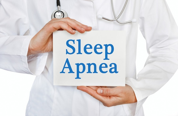 Sleep apnea card in hands of medical doctor