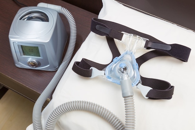 Sleep apnea cpap machine with headgear and hose