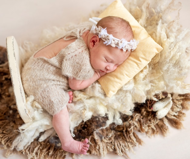 Sleeping baby on wool