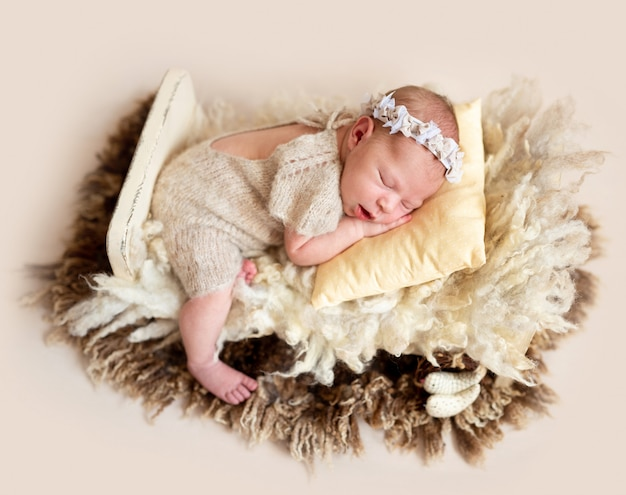 Sleeping baby on wool