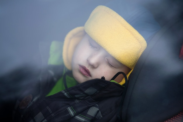 Sleeping boy in the car