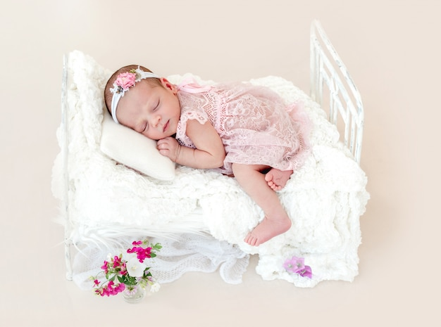 Sleeping newborn baby girl