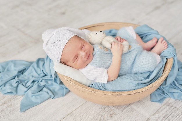 Sleeping newborn baby. healthy and medical concept. healthy child, concept of hospital and happy motherhood. infant baby. happy pregnancy and childbirth. children's theme. baby and childen's goods.