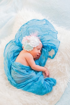 Sleeping newborn girl first photo shoot at home