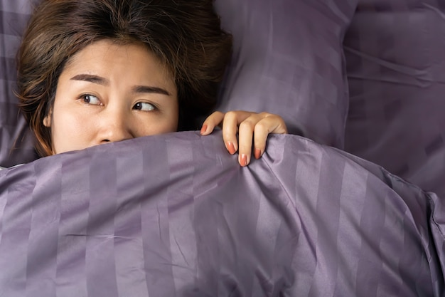 Sleepless asian woman insomnia  in bed