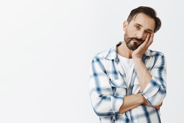Sleepy bearded mature man posing