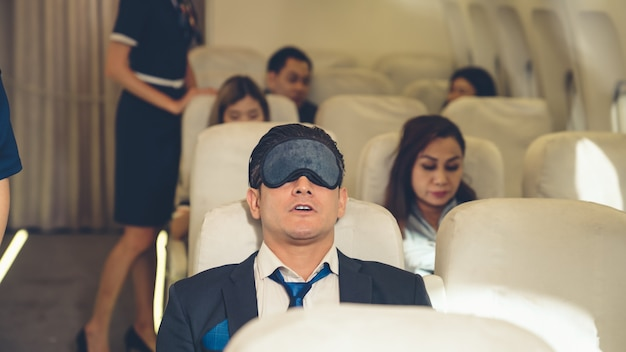 Sleepy businessman travel on a business trip by airplane