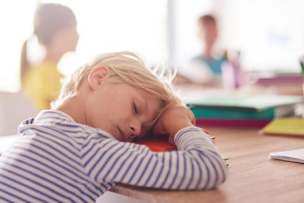 Sleepy day of elementary school pupil