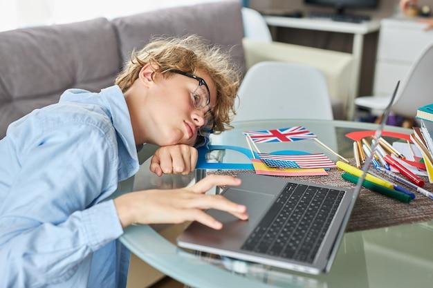 Sleepy exhausted teen boy wants to sleep