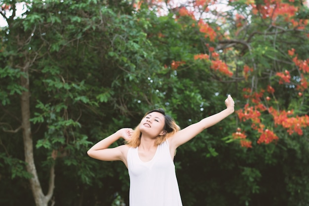Sleepy girl stretching with trees background
