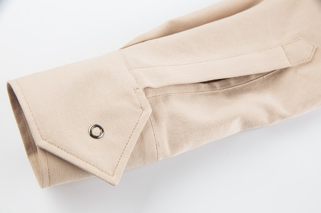 Деталь рукава бежевая хлопчатобумажная ткань застежка-манжета на пуговицах