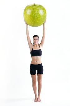 Slender woman in fitness clothes