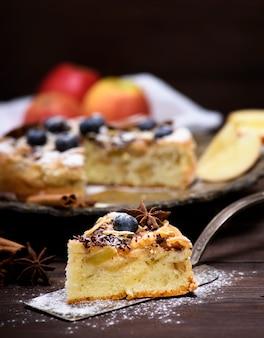 Slice of apple pie on an iron kitchen spatula