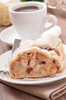 Slice of an apple strudel on the plate