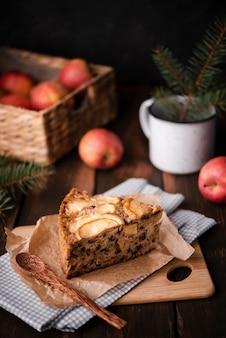 Slice of cake with apples and pine