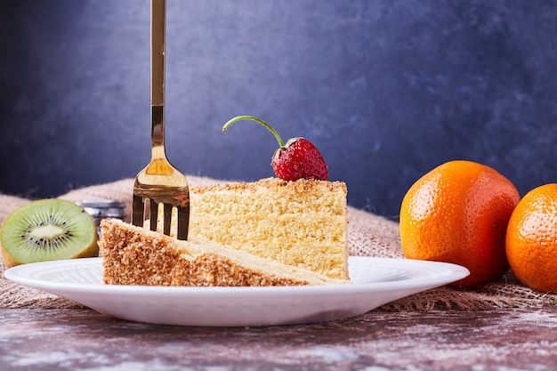 A slice of cake with a fork on it.