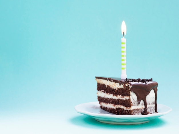 Slice of chocolate birthday cake Premium Photo