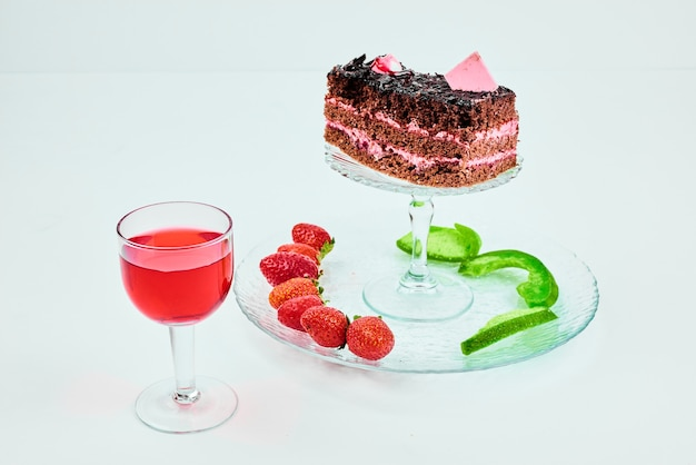 A slice of chocolate cake with fruit composition.