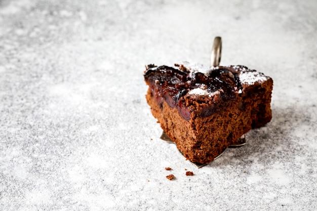 Slice of chocolate cake with plum