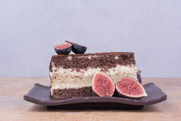 A slice of chocolate cake with purple figs