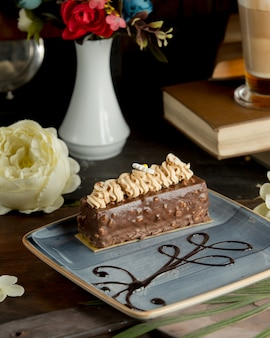 A slice of chocolate cake with walnuts.